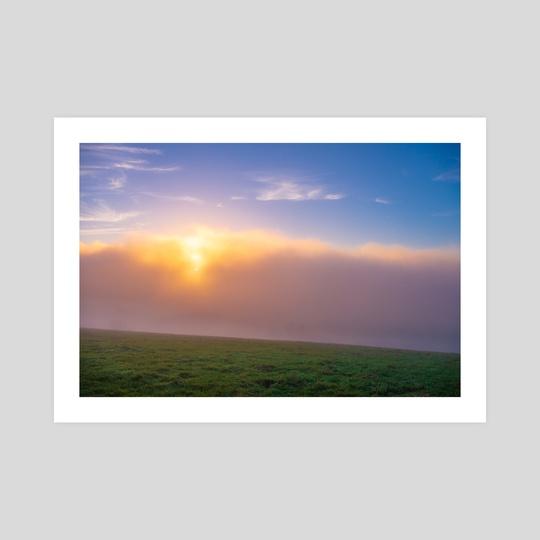 Sun shinning through the clouds onto grass field by Namchetolukla